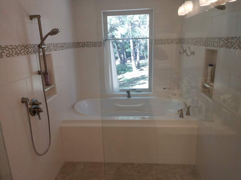 Lake Wildwood Penn Valley, CA Bathtub Shower Remodel by Plumbing Contractor with Bronze Fixtures and tile