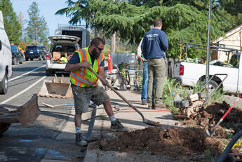 Sewer Line being repaired, guys digging in street and sidewalk, general engineering license to shut down street to make repairs in Grass Valley, CA